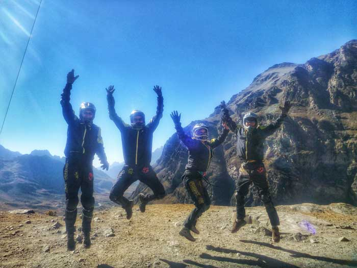biking-group-jump-shot